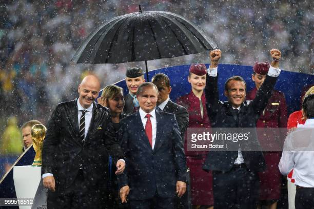 FIFA president Gianni Infantino President of Russia Vladimir Putin and French President Emmanuel Macron are seen following the 2018 FIFA World Cup...