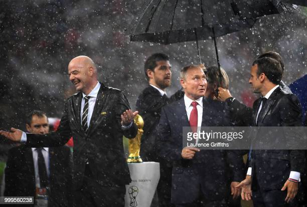 FIFA president Gianni Infantino President of Russia Vladimir Putin and French President Emmanuel Macron are seen on the stage following the 2018 FIFA...