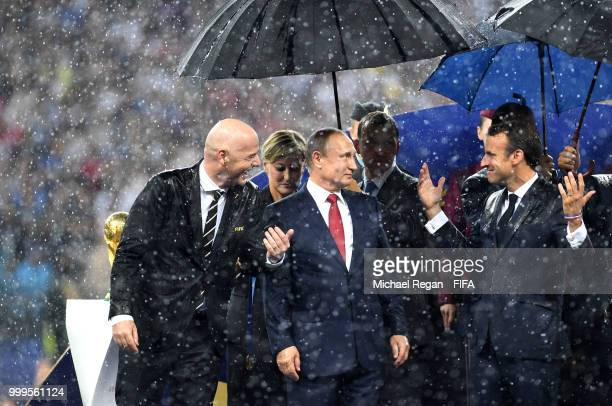 President Gianni Infantino, President of Russia Vladimir Putin and French President Emmanuel Macron chat on the stage following the 2018 FIFA World...