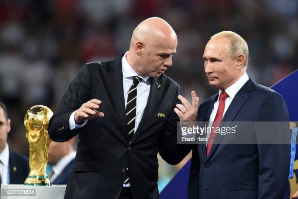 President Gianni Infantino President of Russia Vladimir Putin are seen during the trophy ceremony following the 2018 FIFA World Cup Russia Final...