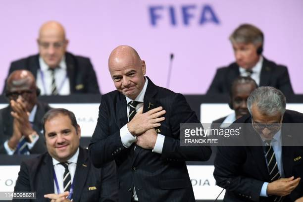 President Gianni Infantino reacts after being reelected by acclamation for a second term at the 69th FIFA Congress at Paris Expo Porte de Versailles...