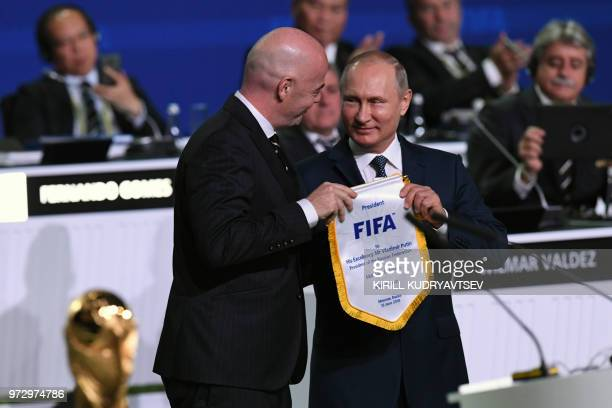 FIFA president Gianni Infantino Russian President Vladimir Putin attend the 68th FIFA Congress at the Expocentre in Moscow on June 13 2018