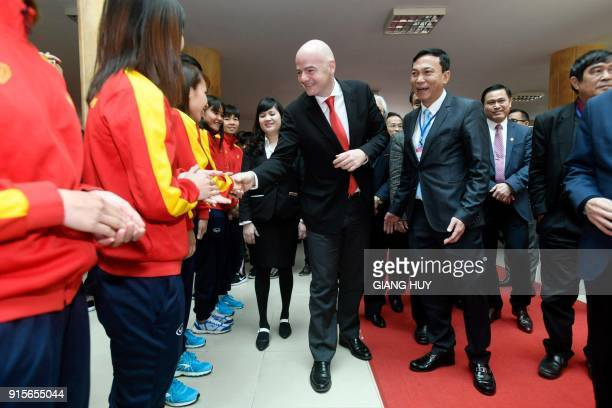 FIFA president Gianni Infantino shakes hands with members of Vietnam's women's national football team during a visit to the Vietnam Football...