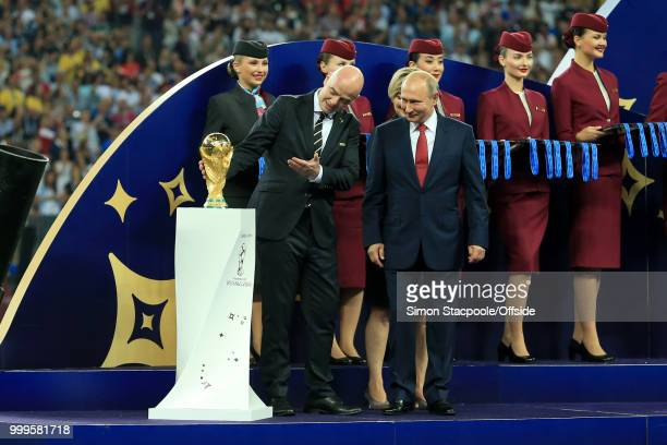 President Gianni Infantino shows off the trophy to Russian President Vladimir Putin before the ceremony at the end of the 2018 FIFA World Cup Russia...