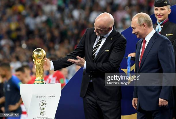 FIFA president Gianni Infantino shows the World Cup trophy to President of Russia Vladimir Putin following the 2018 FIFA World Cup Final between...