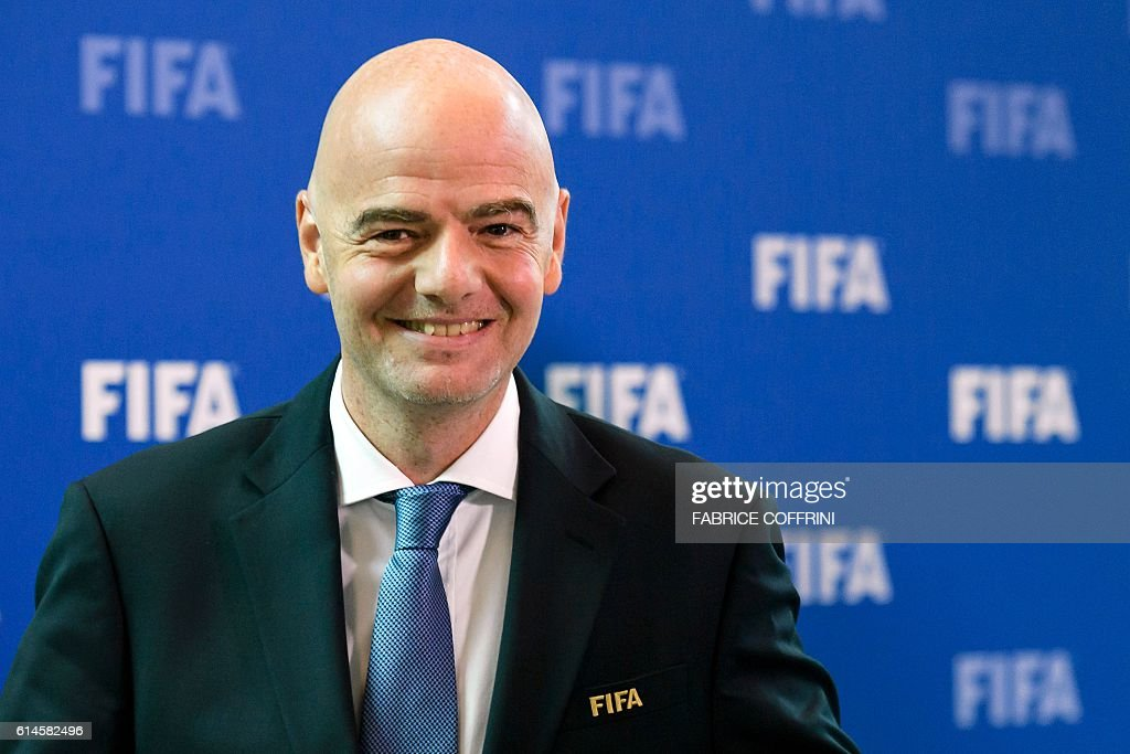 FIFA president Gianni Infantino smiles after a meeting of the FIFA Council on October 14, 2016 at the world football's governing body headquarters in Zurich. FIFA executives will make a final decision on World Cup reform in January after weighing up three proposals on Thursday, as president Gianni Infantino pushes plans to grow the lucrative tournament. / AFP / FABRICE