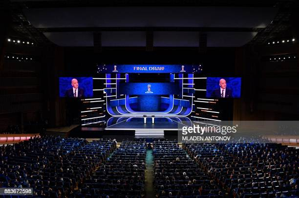 FIFA president Gianni Infantino speaks on stage ahead of the Final Draw for the 2018 FIFA World Cup football tournament at the State Kremlin Palace...