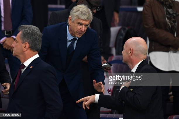 President Gianni Infantino speaks to Arsene Wenger prior to the FIFA Club World Cup Final between Liverpool and Flamengo at Khalifa International...