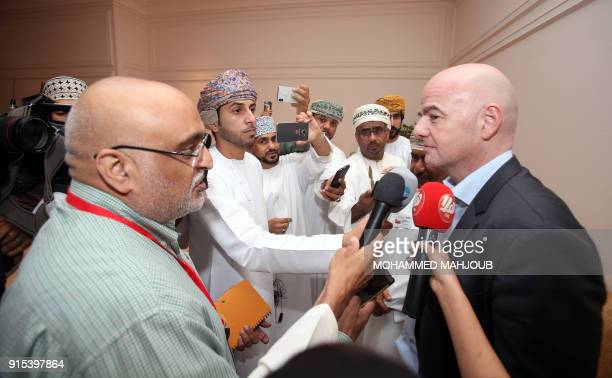 President Gianni Infantino speaks to reporters during the FIFA Executive Summit in the Omani capital Muscat on February 7 2018 / AFP PHOTO / MOHAMMED...