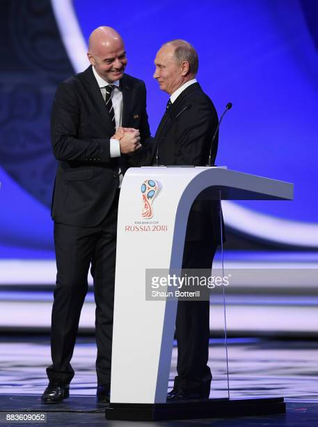 President Gianni Infantino speaks to Vladimir Putin President of Russia as they walk onto the stage during the Final Draw for the 2018 FIFA World Cup...