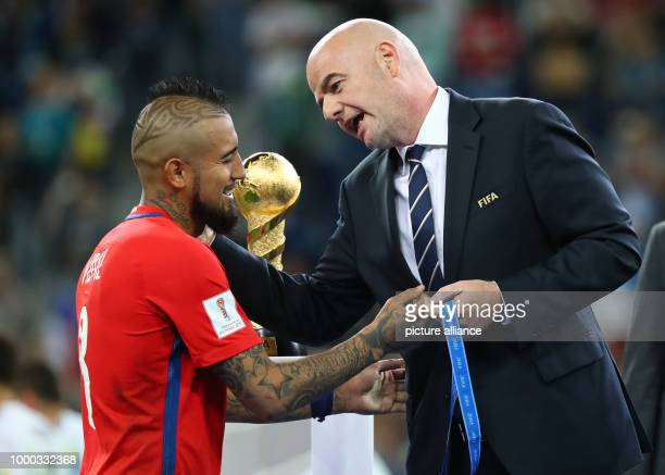 President Gianni Infantino speaks with Chile's Arturo Vidal after the Confederations Cup finale between Chile and Germany at the Saint Petersburg...