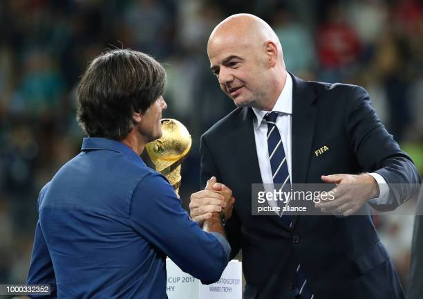 President Gianni Infantino speaks with German head coach Joachim Loew after the Confederations Cup finale between Chile and Germany at the Saint...
