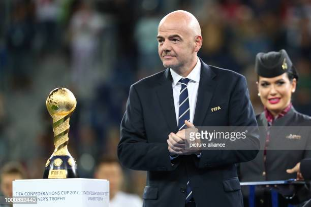President Gianni Infantino stands next to the trophy after the Confederations Cup finale between Chile and Germany at the Saint Petersburg Stadium in...