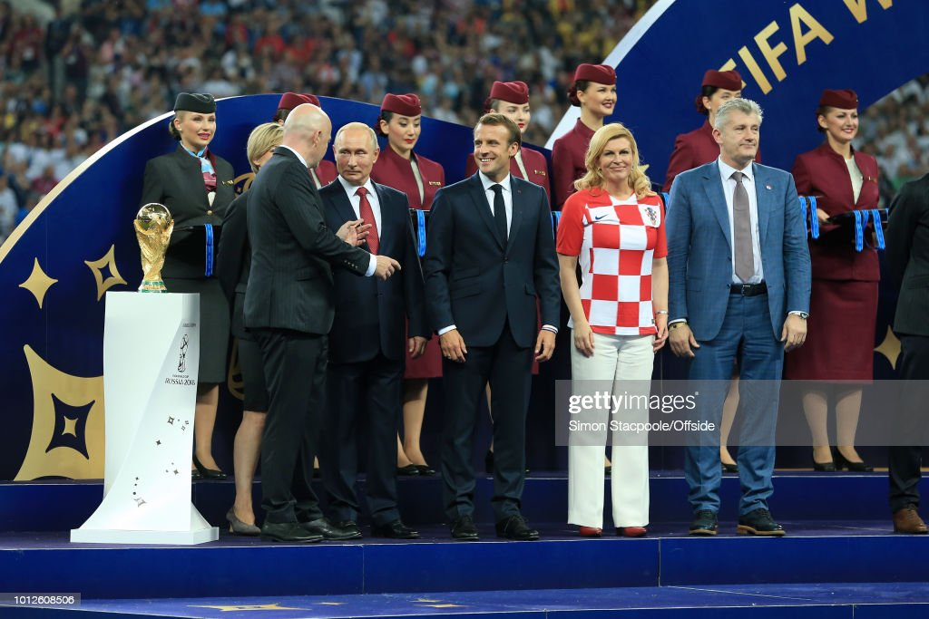 President Gianni Infantino (L) stands on stage next to the trophy alongside Russian President Vladimir Putin (2L), French President Emmanuel Macron (C), Croatian President Kolinda Grabar-Kitarovic (2R) and former Croatia player Davor Suker (R) ahead of the presentations after the 2018 FIFA World Cup Russia Final between France and Croatia at the Luzhniki Stadium on July 15, 2018 in Moscow, Russia.