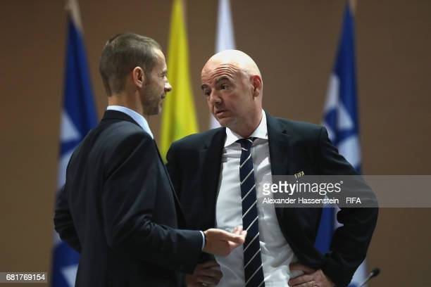 President Gianni Infantino talks to FIFA Council Member and UEFA President Aleksander Ceferin during the 67th FIFA Congress at the Bahrain...