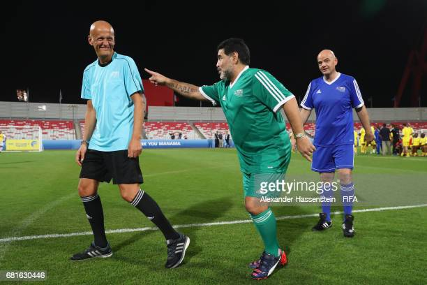 President Gianni Infantino talks to FIFA Legend Diego Maradona of Argentina and referee Pierluigi Collina of Italy prior to a FIFA Football...