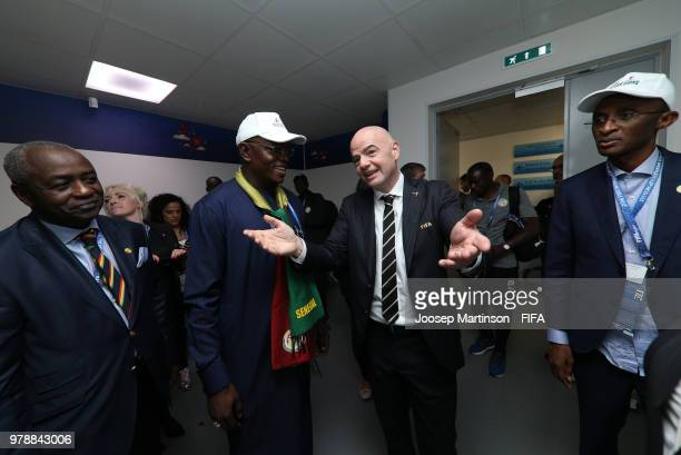 FIFA president Gianni Infantino talks to Macky Sall president of Senegal following the 2018 FIFA World Cup Russia group H match between Poland and...