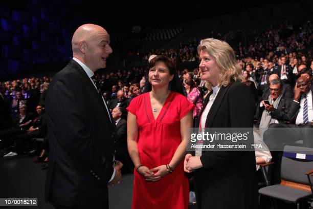 President Gianni Infantino talks with Brigitte Henriques during the FIFA Women's World Cup France 2019 Draw at La Seine Musicale on December 8 2018...
