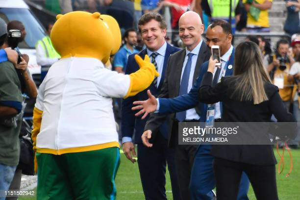 President Gianni Infantino the president of the South American football's governing body Conmebol Paraguayan Alejandro Dominguez and Brazilian former...