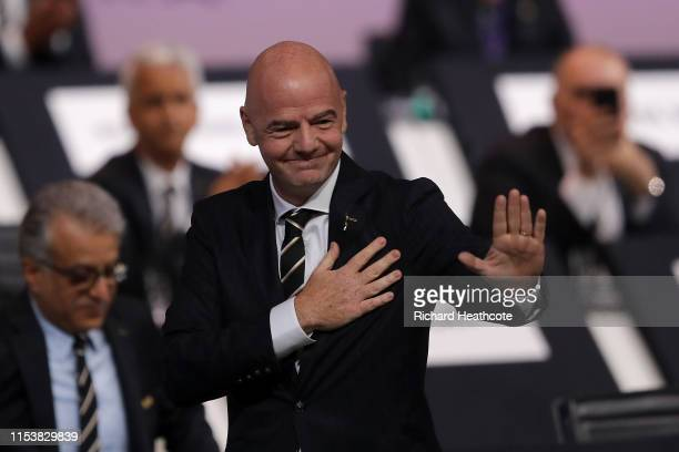 President Gianni Infantino walks back on stage after being reelected as President during the 69th FIFA Congress at the Paris Expo Porte de Versailles...