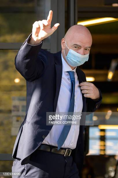 President Gianni Infantino waves as he arrives for a UEFA congress, during which in he is expected to deliver his verdict on the European Super...