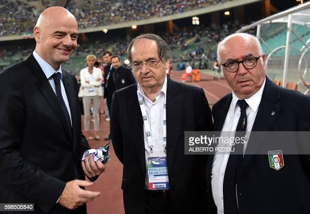 FIFA president Giovanni Infantino French football association president Noel Le Graet and Italy's football association president Carlo Tavecchio...