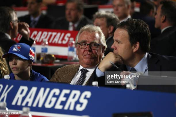 President Glen Sather left of the New York Rangers looks on from the draft table during Round One of the 2017 NHL Draft at United Center on June 23...
