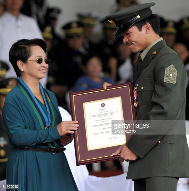 President Gloria Arroyo awards Philippine Legion of Honor for Sport and a military merit medal to World Boxing Council lightweight champion Manny...