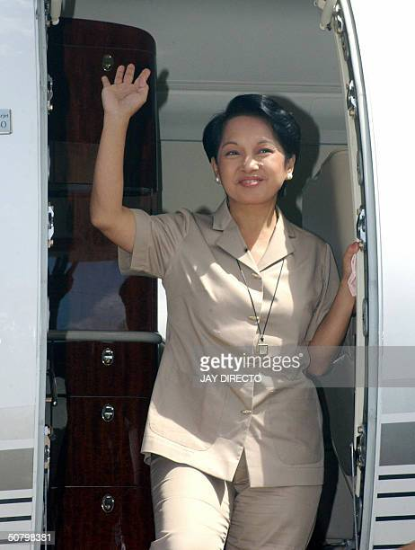 President Gloria Arroyo waves to supporters as she arives in Legazpi Albay for a campaign rally south of Manila 04 May 2004 ahead of the May 10...