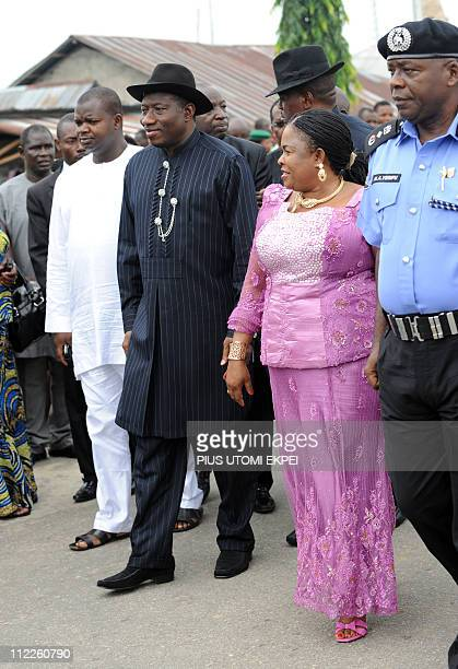 President Goodluck Jonathan and wife Patience arrive at the polling booth to be accredited by INEC officials for the presidential election at Otuoke...