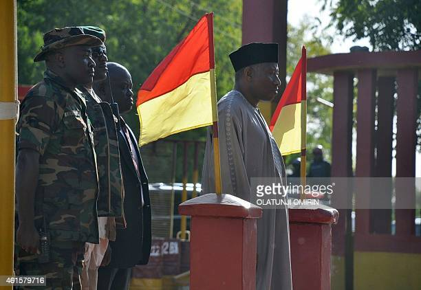 President Goodluck Jonathan stands to take salute from soldiers at the 7th Division of the Nigerian Army fighting Boko Haram terrorists during a...