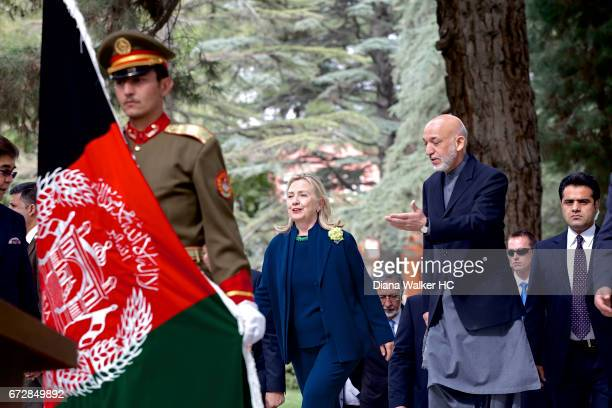 President Hamid Karzai of Afghanistan and Secretary of State Hillary Rodham Clinton walk to a joint press conference on October 20, 2011 in the...