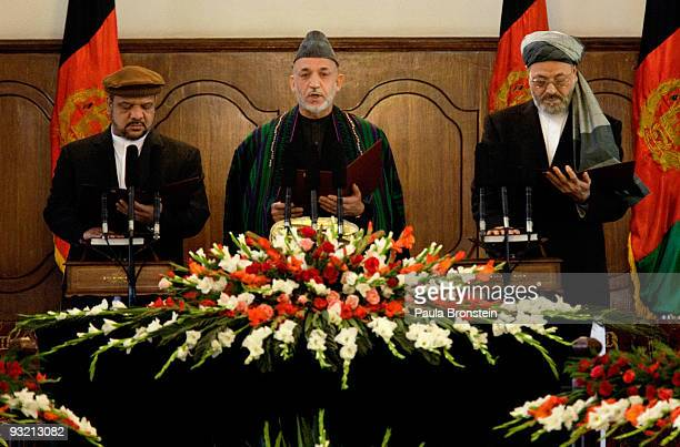 President Hamid Karzai recites taking the oath of office along side First Vice President Mohammad Qasim Fahim and Second Vice president Kareem...