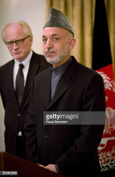 President Hamid Karzai stands next to Kai Eide, Special Representative of the United Nations Secretary-General for Afghanistan, during a joint news...