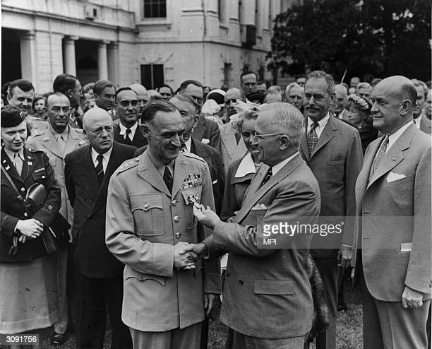 President Harry S. Truman awarding American General Lucius Clay with the Distinguished Service Medal for his role in the Berlin Airlift.