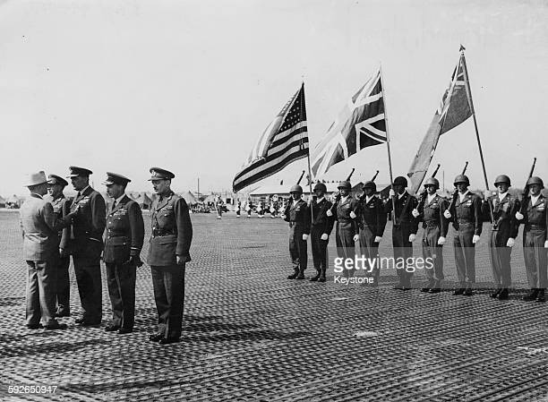 US President Harry S Truman decorating a group of officers General H D G Crerar Air Marshal Sir Arthur Coningham Air Marshal Sir James Robb and Major...