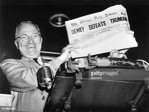 President Harry S Truman gaily displays an issue of the Chicago Daily Tribune with the headline Dewey Defeats Truman
