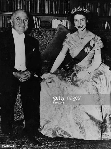 President Harry S Truman sitting with Princess Elizabeth during a dinner at the Canadian Embassy in Washington DC circa 1950