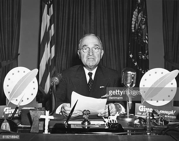President Harry S Truman speaks during a television address from the Oval Office