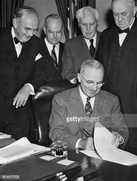 President Harry Truman signs the Marshall Plan into effect on April 03, 1948 in Washington the day after the US Congress passed the Economic...