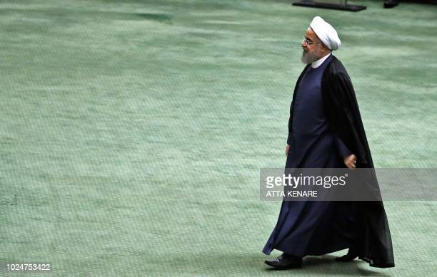 TOPSHOT President Hassan Rouhani arrives at the Iranian Parliament in the capital Tehran on August 28 2018 It was the first time Rouhani had been...