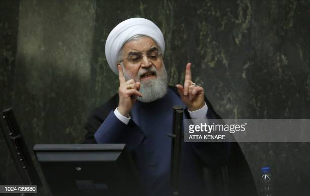 TOPSHOT President Hassan Rouhani speaks at the Iranian Parliament in the capital Tehran on August 28 2018 It was the first time Rouhani had been...