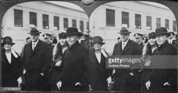 President Herbert Hoover and his wife Lou board an 1879 model train at the Light's Golden Jubilee with inventor Thomas Edison and his wife Mina, 21st...