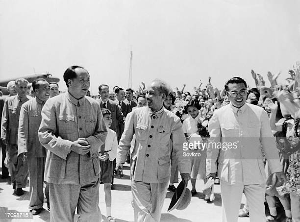 President ho chi minh of the democratic republic of vietnam being met at the airport by chairman mao zedong upon his arrival in peking china on june...