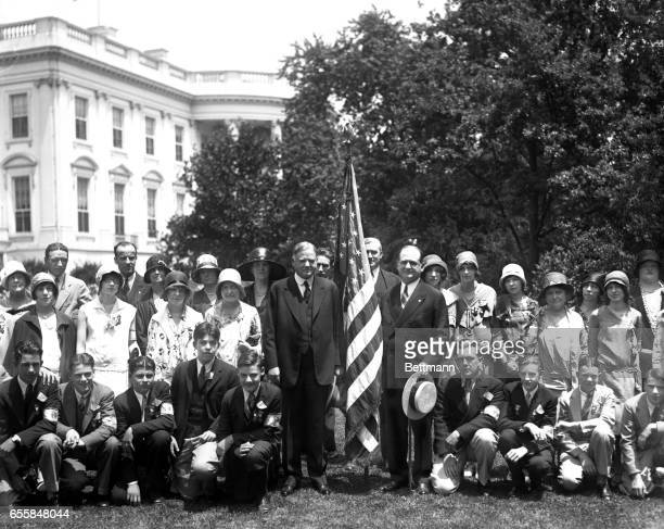 President Hoover received the regional winners in the flag contest sponsored by the Hearst Publications at the White House today Kneeling in front...