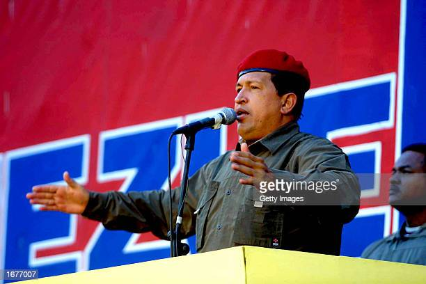 President Hugo Chavez addresses supporters during a massive rally December 7 2002 in front of the Miraflores presidential palace in Caracas Venezuela...