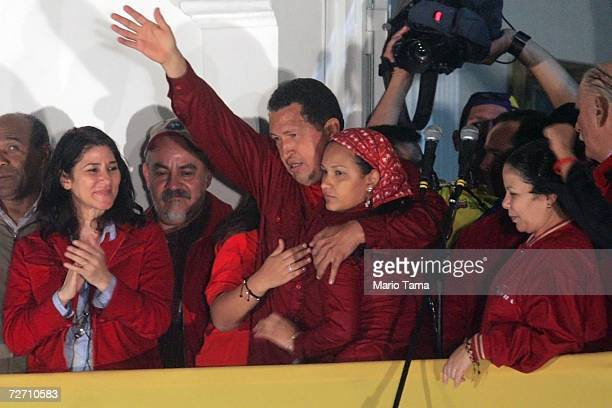 President Hugo Chavez waves to the crowd after delivering his victory speech at Miraflores Palace following the presidential elections December 3...