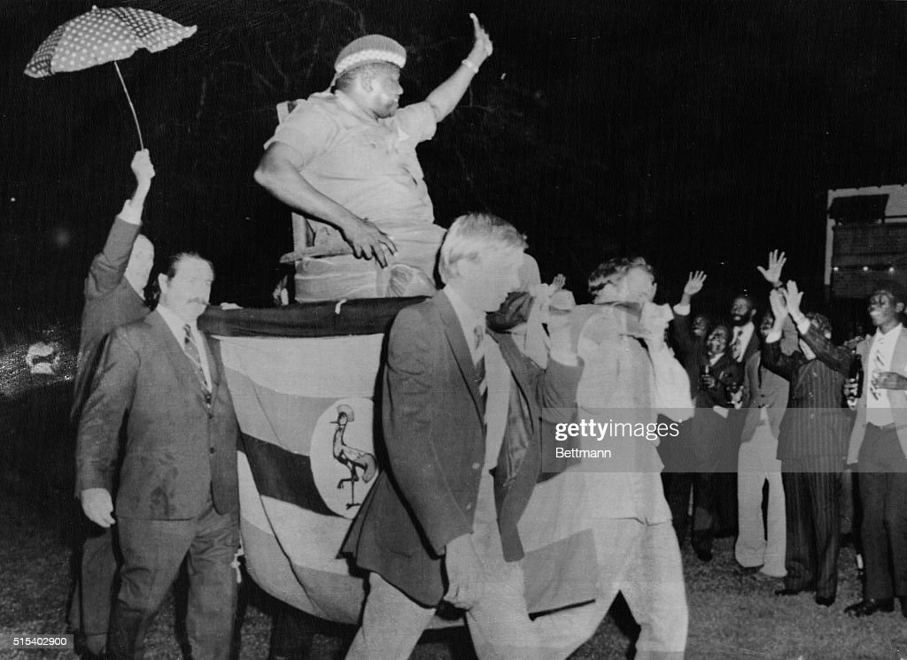 President Idi Amin is carried by four Britons into official reception here 7/18 on a makeshift throne. It was Amin's idea, to show new white mans burden in Africa, and also to try and improve relations between Britain and Uganda.