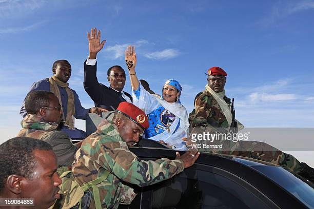 President Idriss Deby with his wife Hinda Deby wave from a car on December 18 2012 in Biltine Chad
