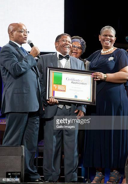 President Jacob Zuma and Ethekwini mayor Zandile Gumede honour Ladysmith Black Mambazos retired lead vocalist Joseph Shabalala with a certificate of...